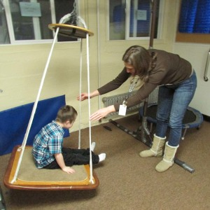 Special Needs Assistant Tina Wilson works with a student in the sensory lab at Eugene Field School.