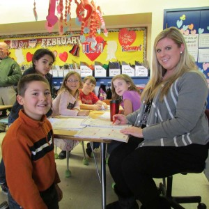 Central Howell School teacher Ashley Crisell works on math bar models with a group from her second grade class.