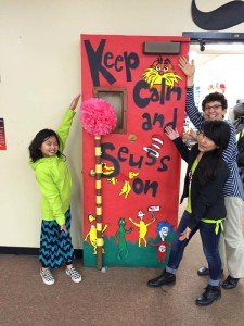 Fifth graders Laura Paige (left) and Lily Godson with teacher Grethel Alden show off the winning door from the Dr. Seuss door-decorating contest at Robert Frost School to celebrate National Literacy Month.