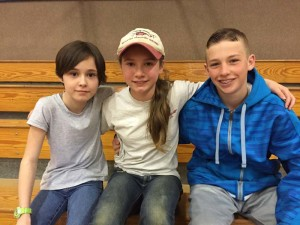 Silver Crest Elementary School students Briley Bergerson and Emma Laugle, grade 6 with Tristan Allen, grade 7, take a minute to share their experiences as reading buddies to younger students.