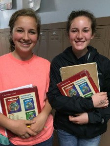Eighth graders Amanda Stadeli and Emma Andrews sport friendly grins between classes at Mark Twain Middle School.