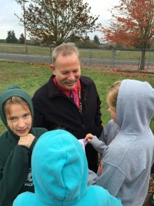 Evergreen students show their paper helicopters to Superintendent Andy Bellando.