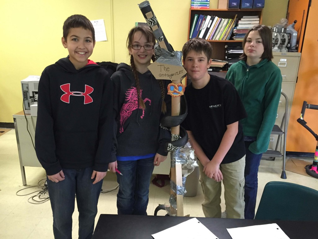 """Students in Stacie Watts' class show off their roller coaster project """"The Antagonizer."""" (From left) Neil Efimov, Natalia Frolov, Micah Larson Schweickert, and Sarah Ackerman."""