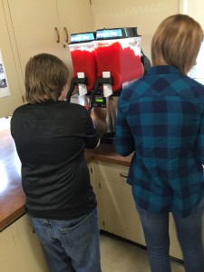 A Mark Twain student tests the new slushy machine with teacher Jillian Fierro.