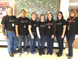 Superintendent Andy Bellando joins members of the Mark Twain Middle School team to show off their new Silverton Middle School T-shirts. From Left: Andy Bellando, Jeff Fierro, Sarah Wiesner, Darby Hector, Kathleen Kelley, Maureen Powell, Nancy Griffith