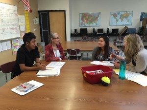 Educational Assistant Monica Hanson with Silverton High School sophomore Manuel (Manny) Loyola (left), freshman Eva Alcala (right) and ELD teacher Cheryl Klopfenstein.