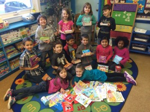 "Silver Crest kinders show off the new Rebus Books purchased with funds raised from a recent Jog-a-thon called ""Booking it for Books""."