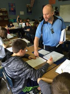 Silver Crest teacher Shawn Pool, helps students during class.