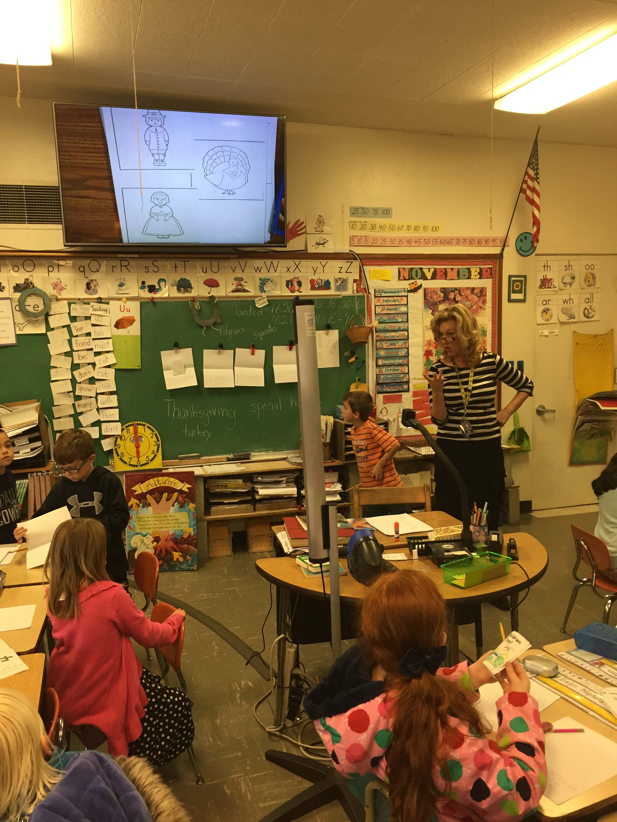 Kindergarten students at Central Howell School use their new high definition screen to learn about Thanksgiving.