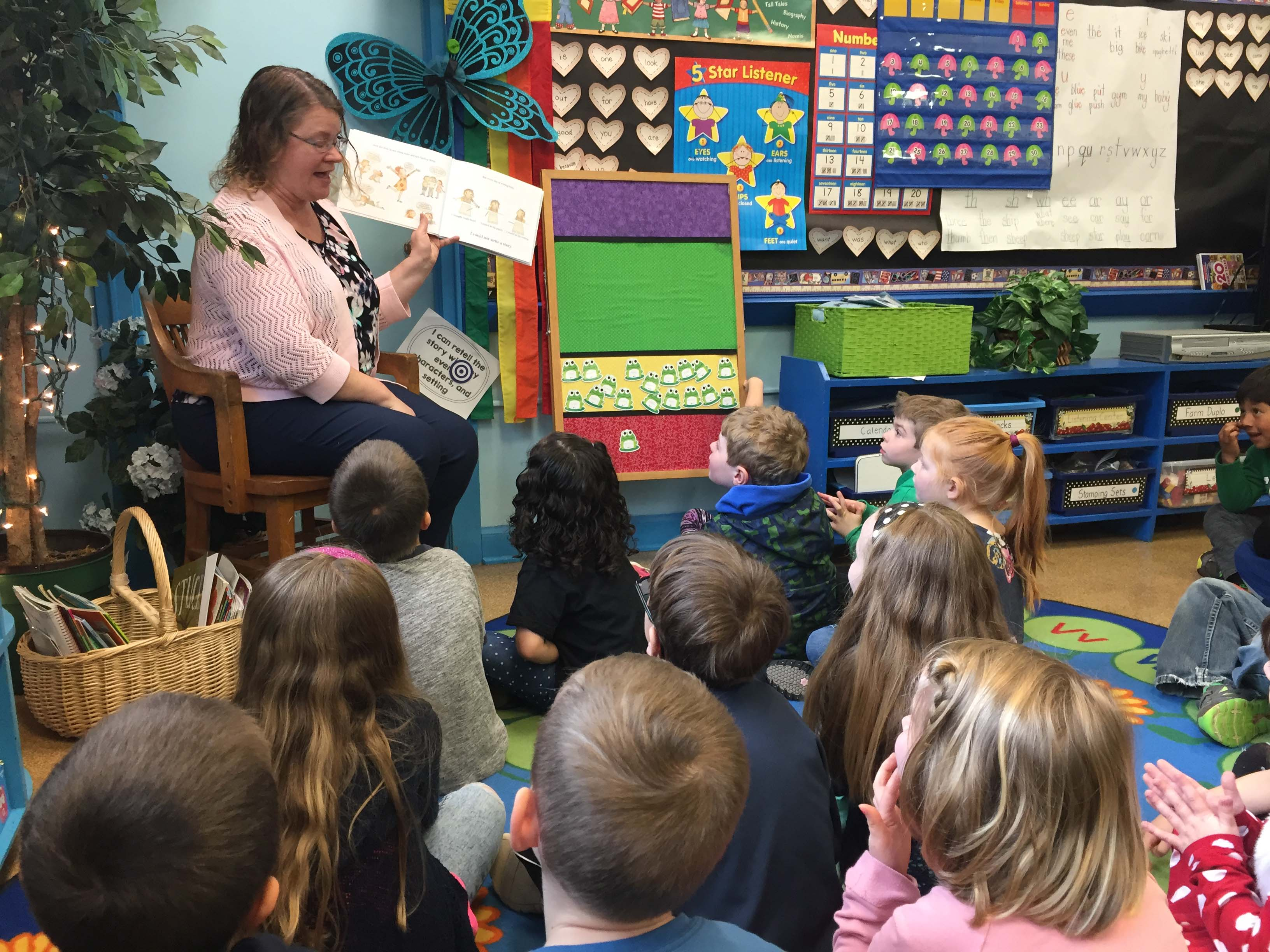 Kindergarten teacher Christine Guenther reads with her class at Silver Crest School.