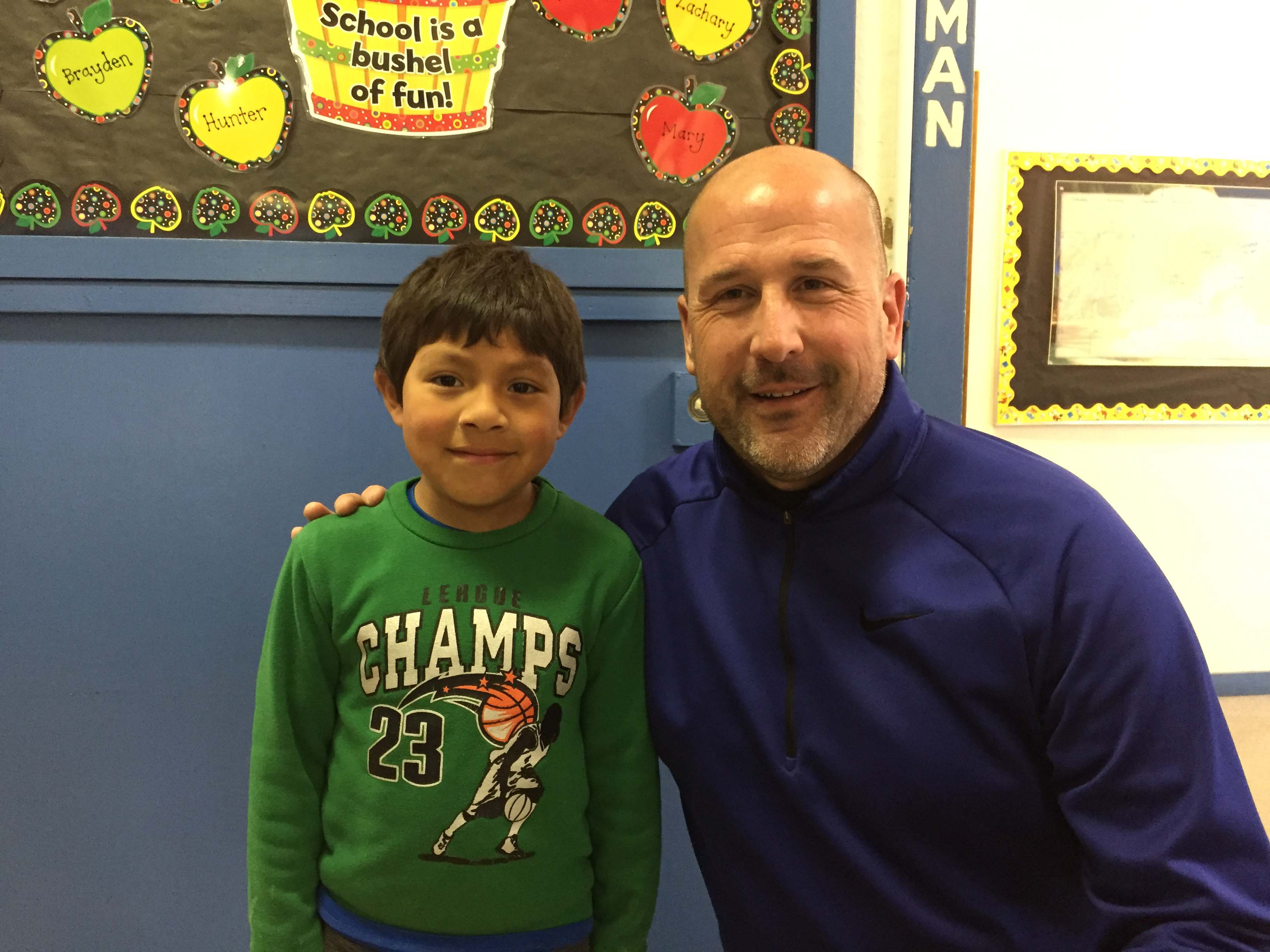 Silver Crest Principal Mark Hannan with kindergarten student Adrian Sosa. Hannan says Sosa makes him smile everyday.