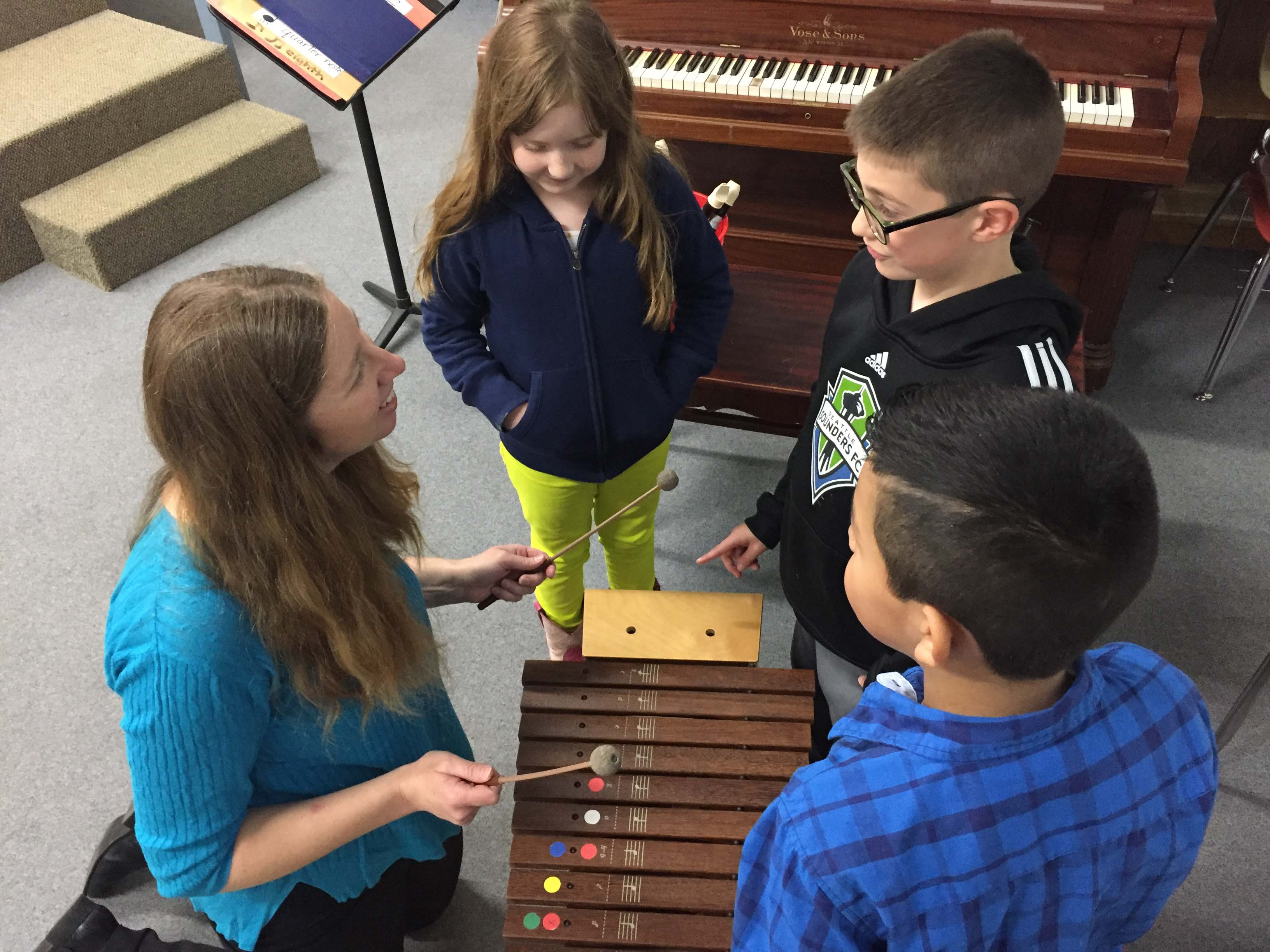 Musician mom Katie Pool volunteers her time to bring music class to Silver Crest every Wednesday.