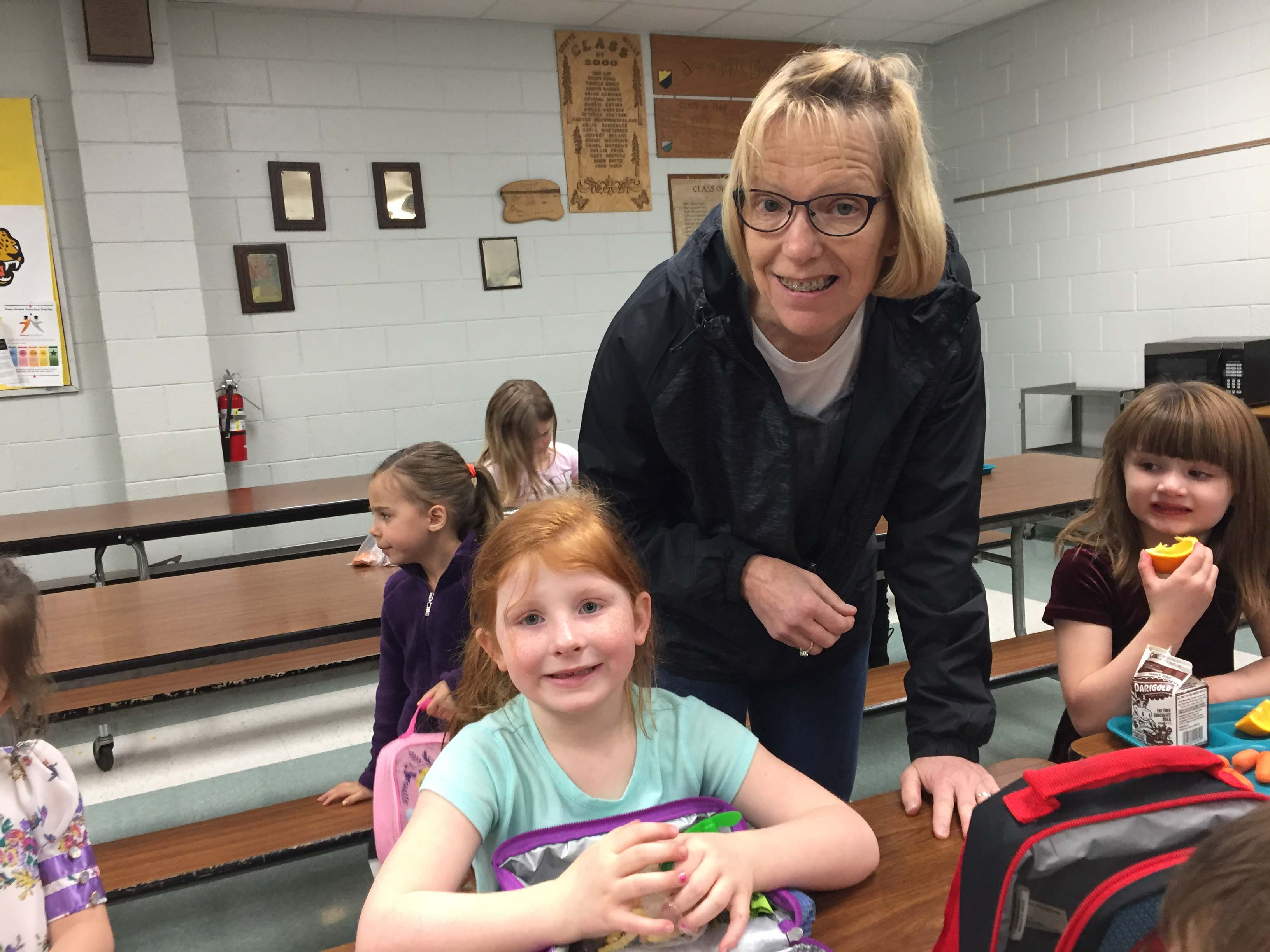 Scotts Mills kindergartener Evelyn Jorgenson at lunch with her teacher Karen Steers.