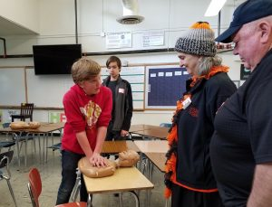 SMS student Murphy Bell, grade 8, demonstrates CPR for guests at the Annual Senior Breakfast.