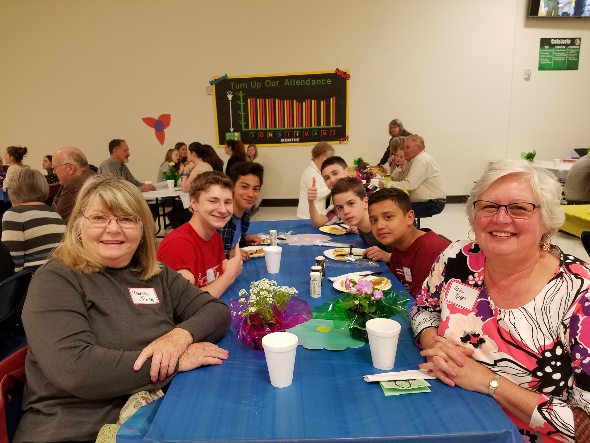 SMS students enjoy breakfast with community members during the annual Senior Breakfast.