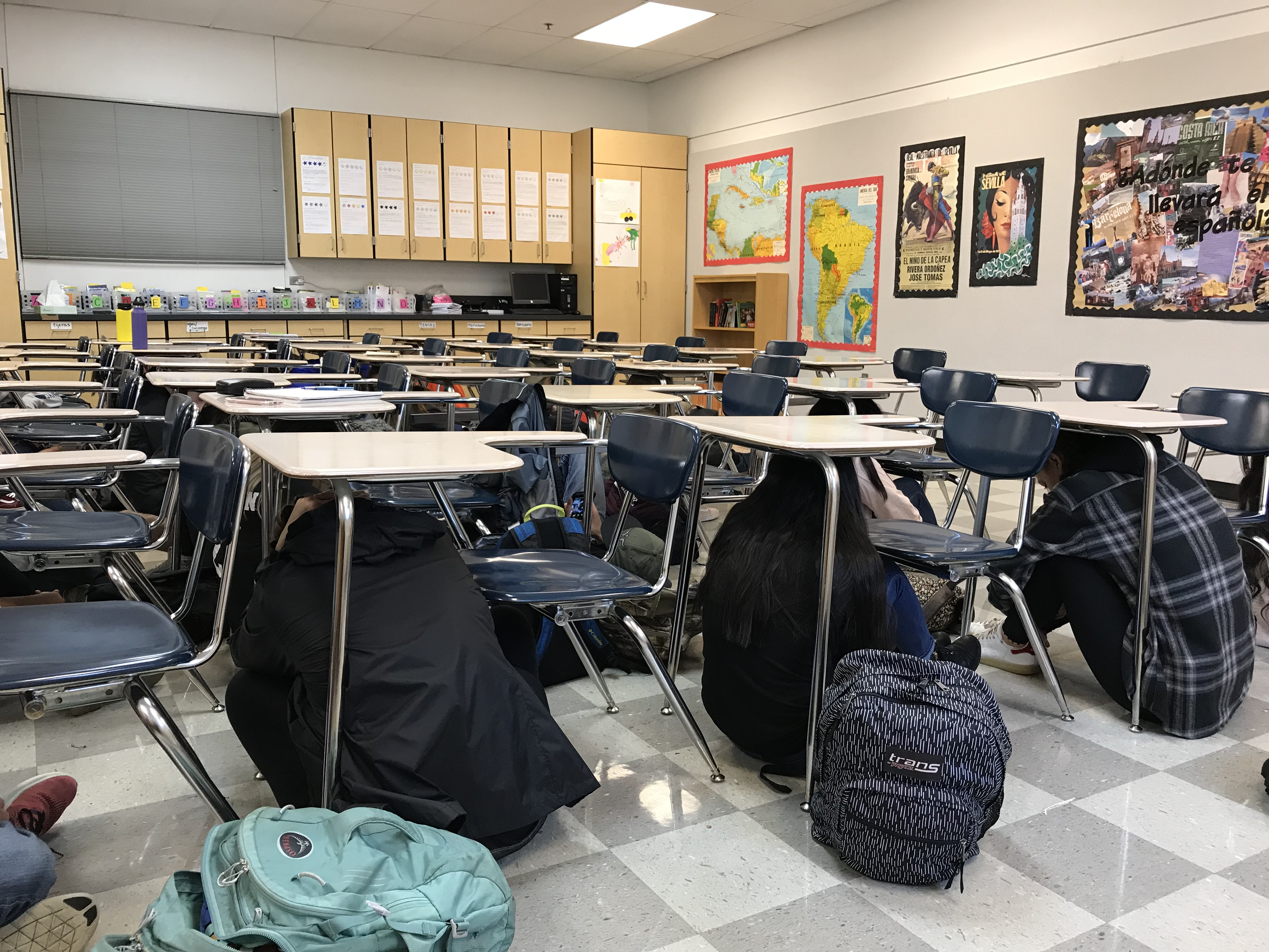 Silverton High School students participate in an earthquake drill during the Great Oregon Shakeout