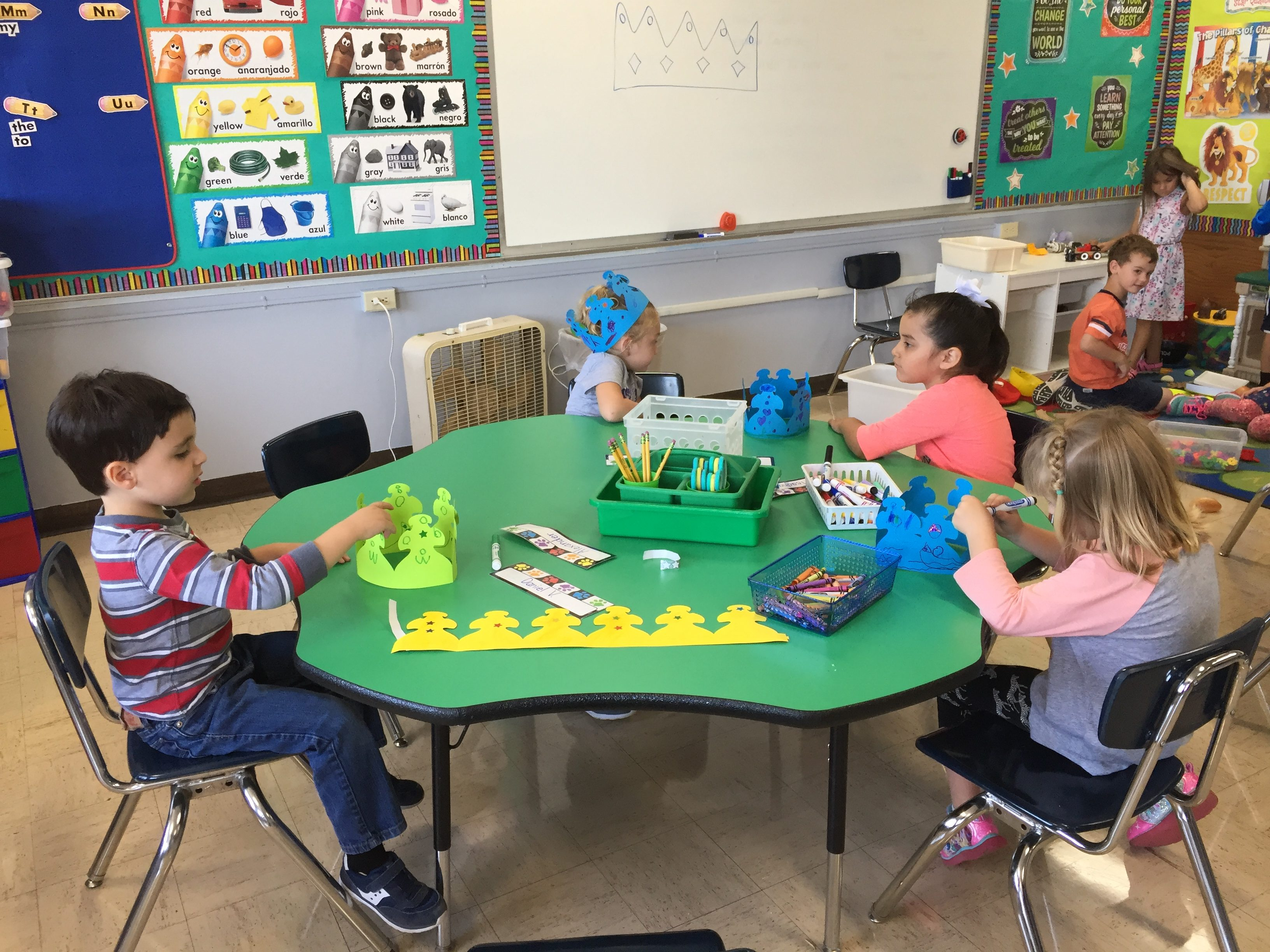 Students learn & play at a table during class