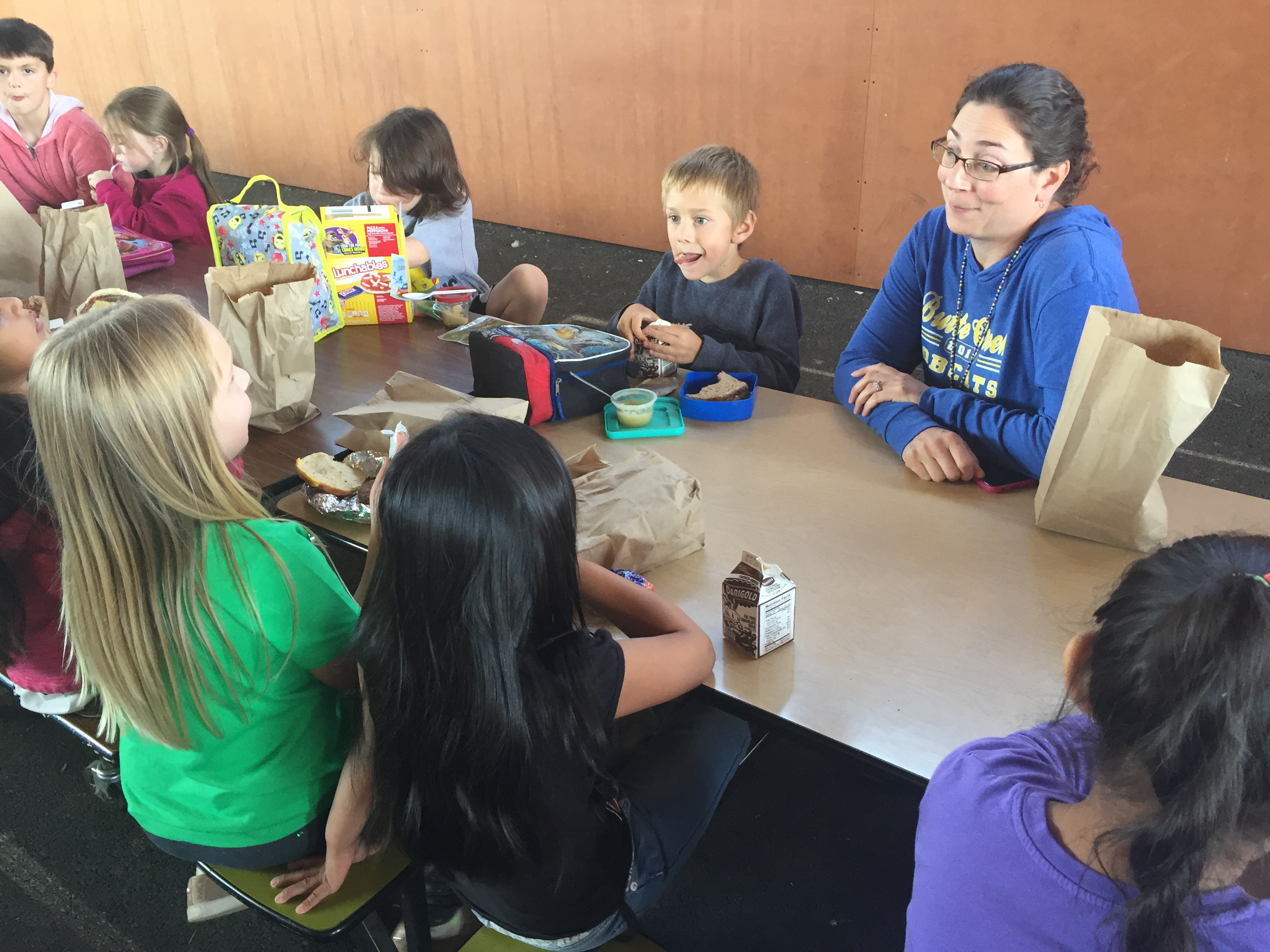 Butte Creek principal Therese Gerlits visits with students during lunch.