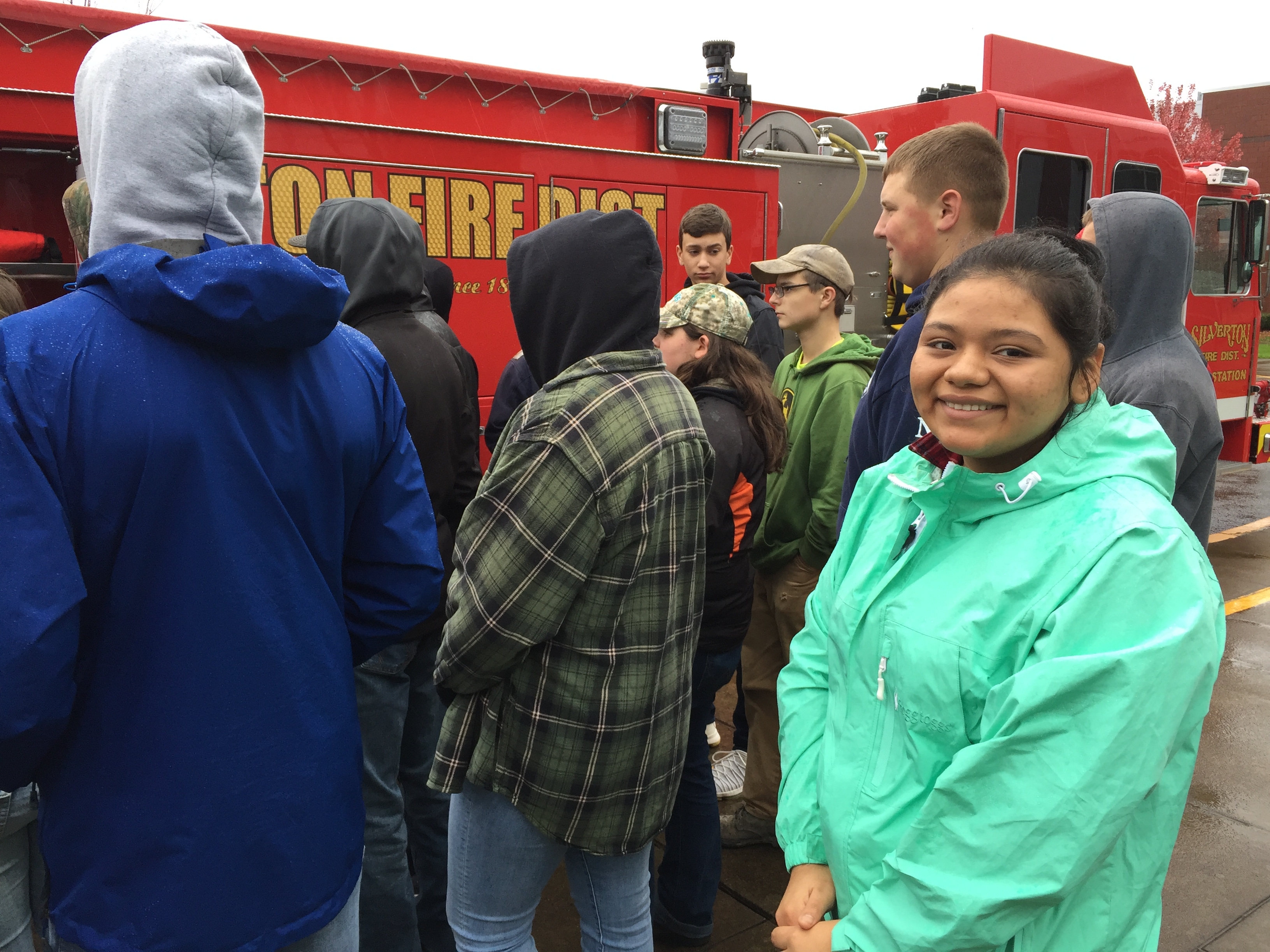 Senior Jasmine Pacheco participates in a demonstration from Silverton Fire Department as part of the SHS Protective Services Program.