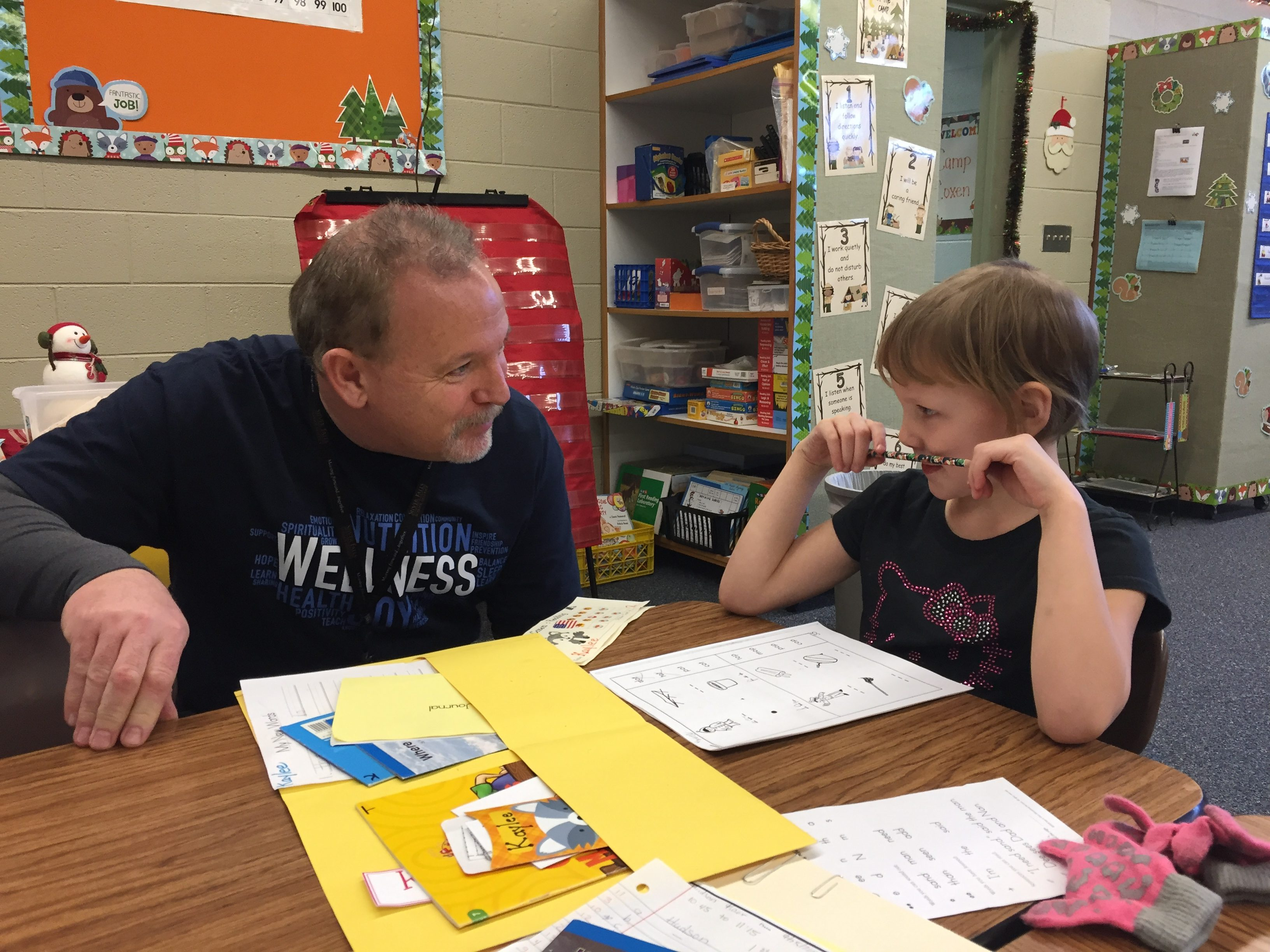 Superintendent Andy Belando checks in with students during reading activities at Mark Twain Elementary.