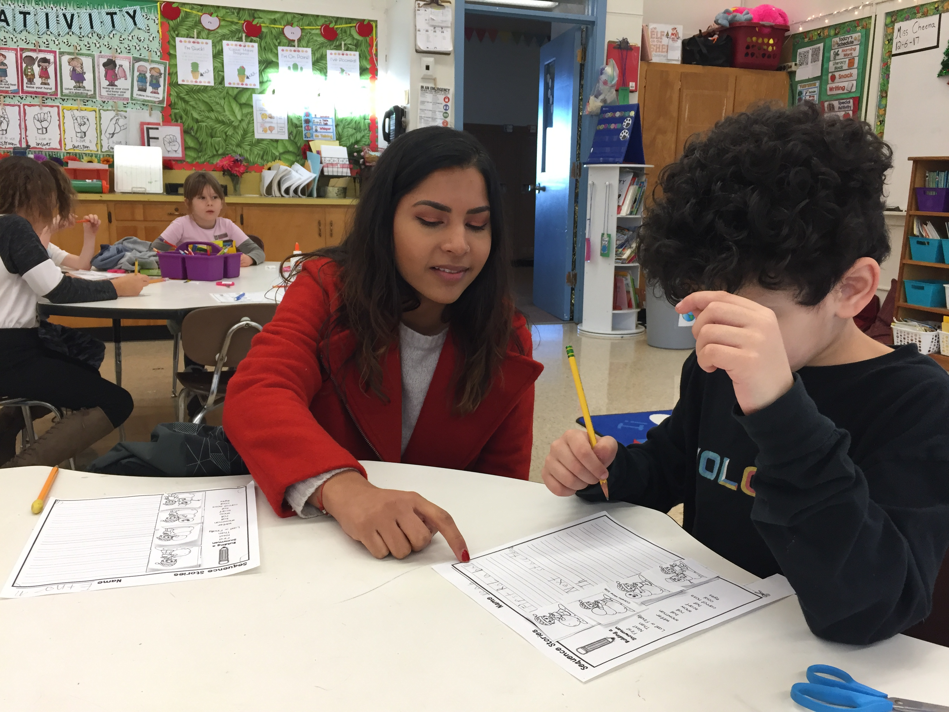 Najma Cheema leads reading activities with students before lunch.