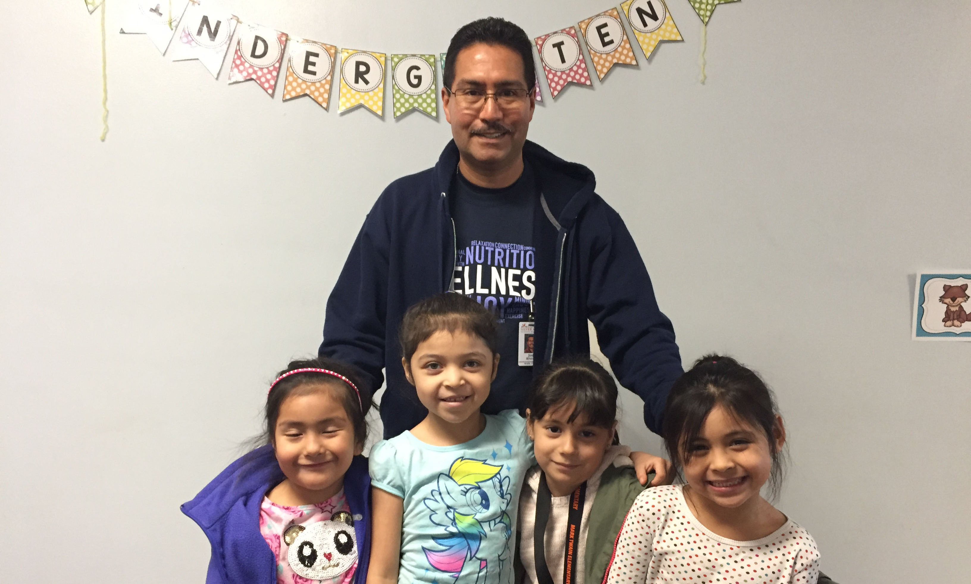Educational Assistant Jose Rivera visits with students from the ELL/ELD program.