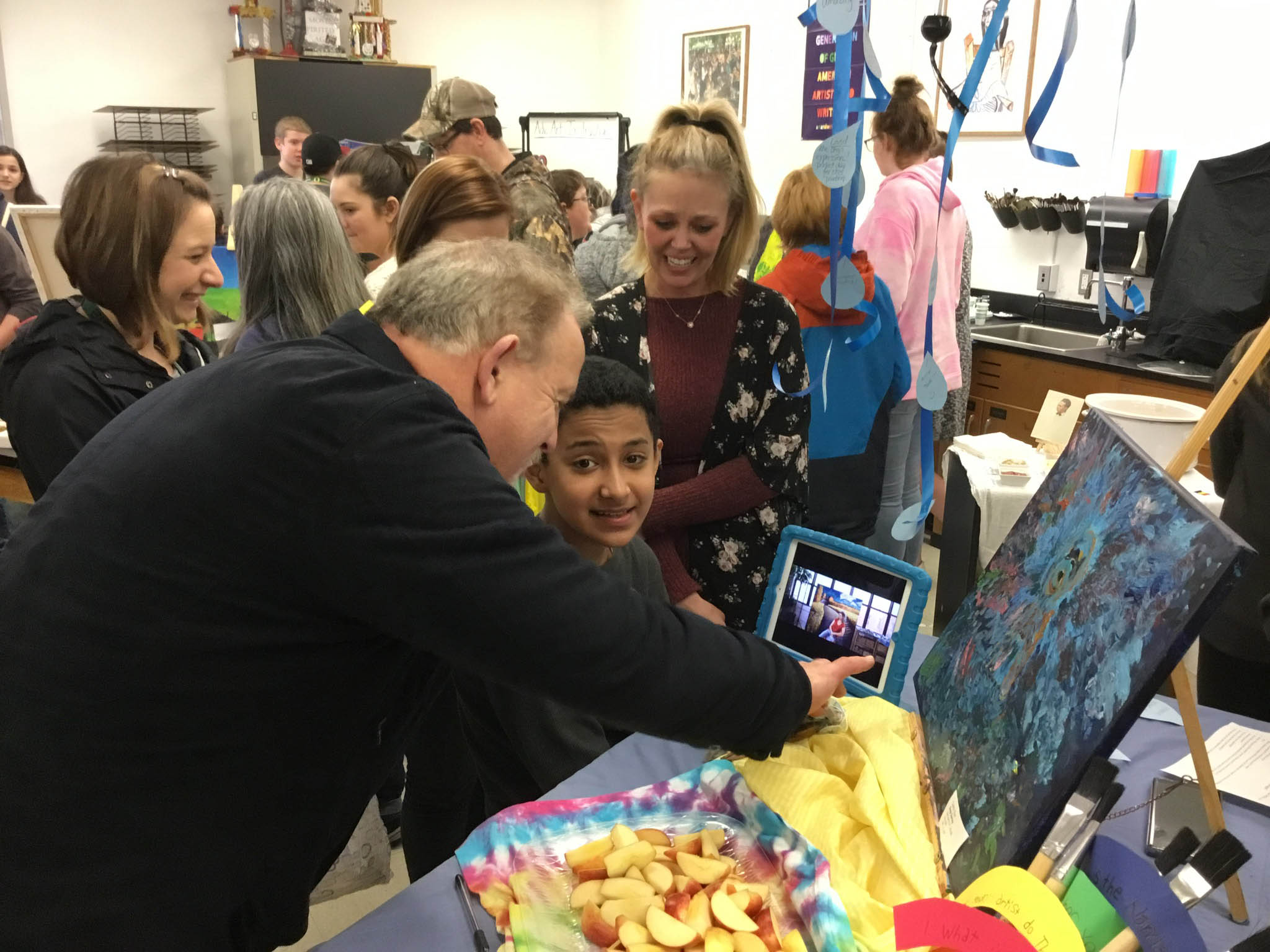 SFSD Superintendent Andy Bellando gets a close up look at student art during the Silverton Middle School Lunch and Learn Art Opening