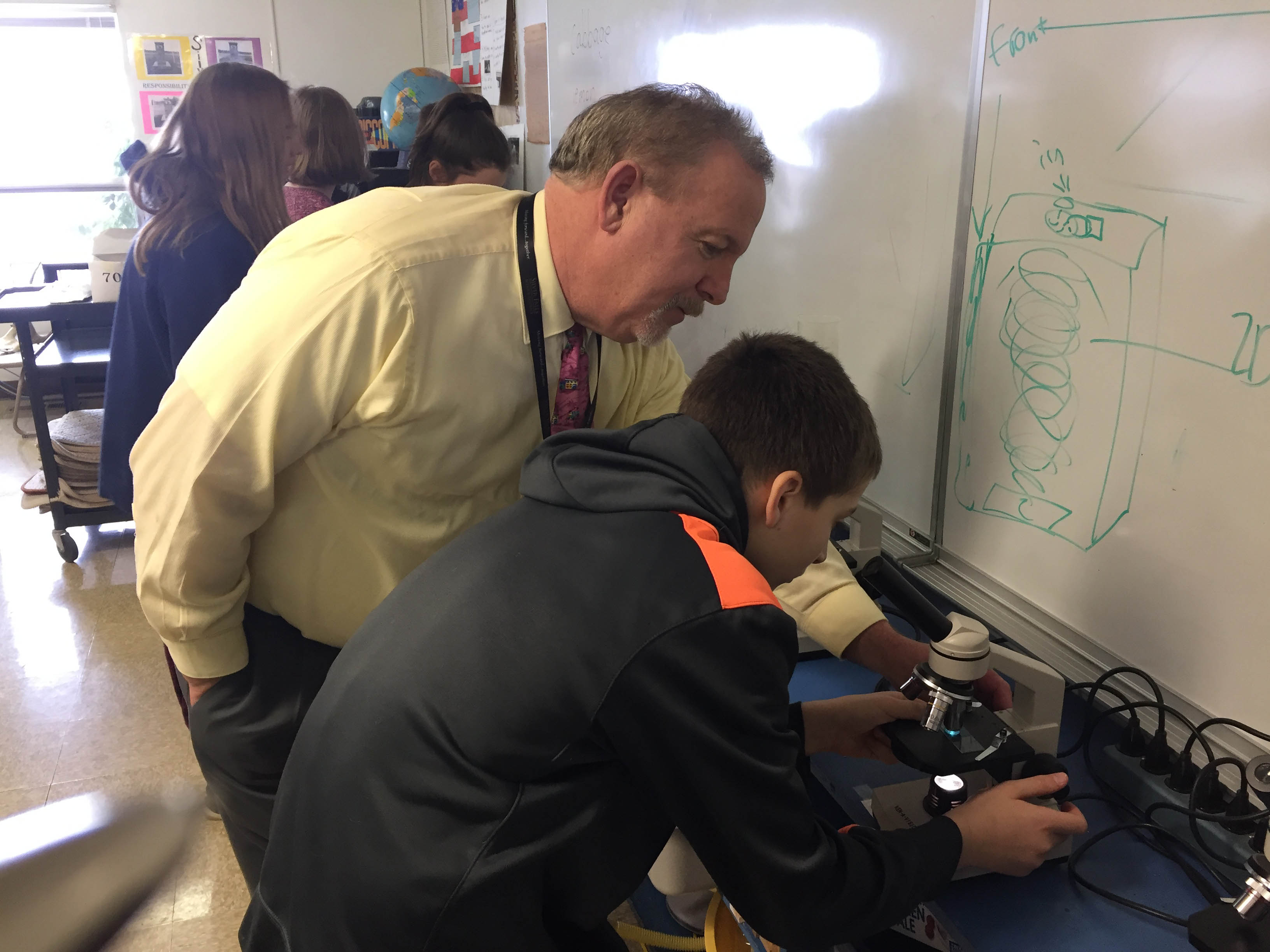 Superintendent Bellando with a Student