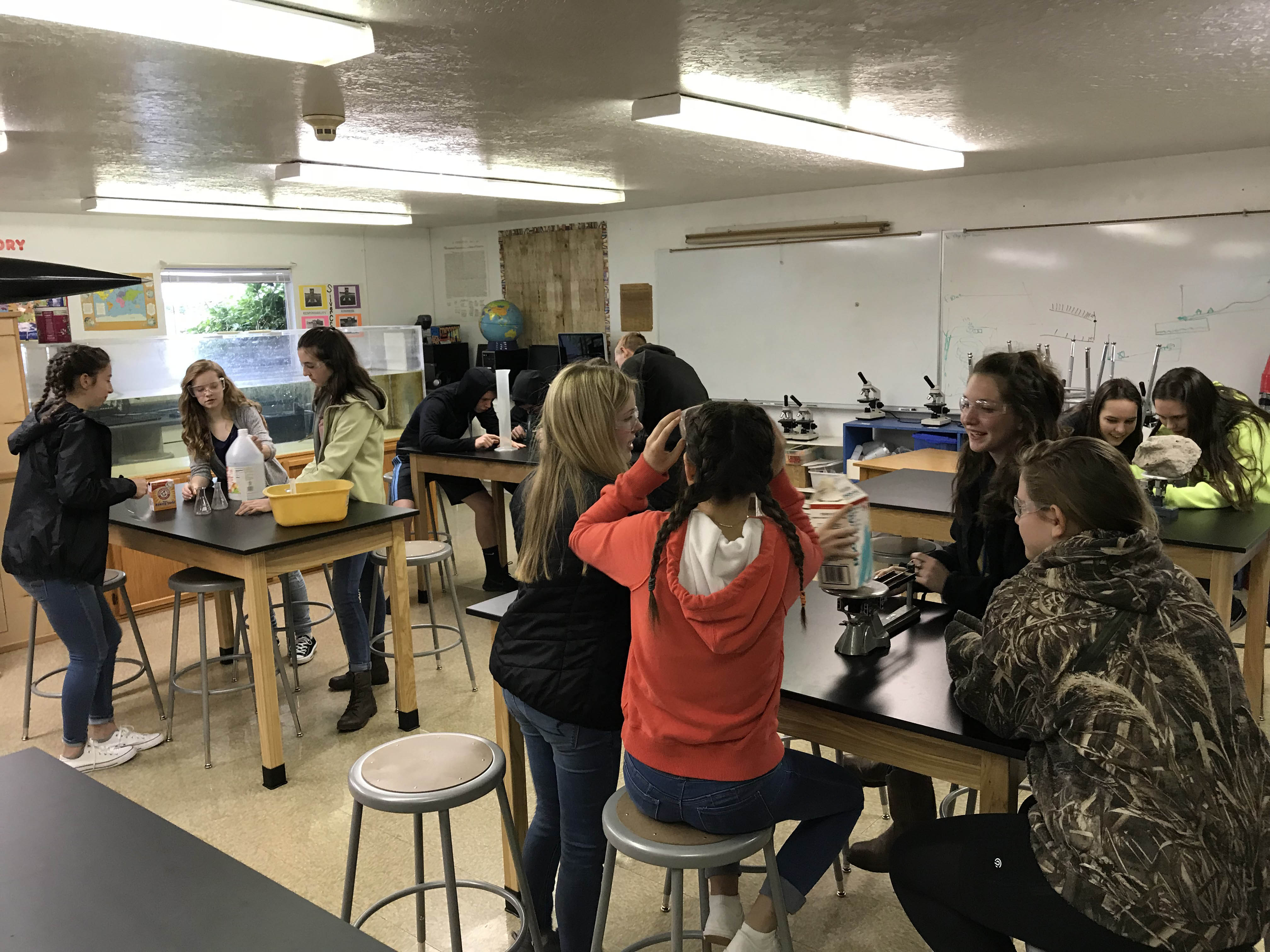 8th Grade Students at Silverton Crest Participate in Science activities on their new tables