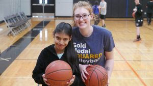 Unified Basketball Team Members Araceli Gaspar and Jordyn Hansen