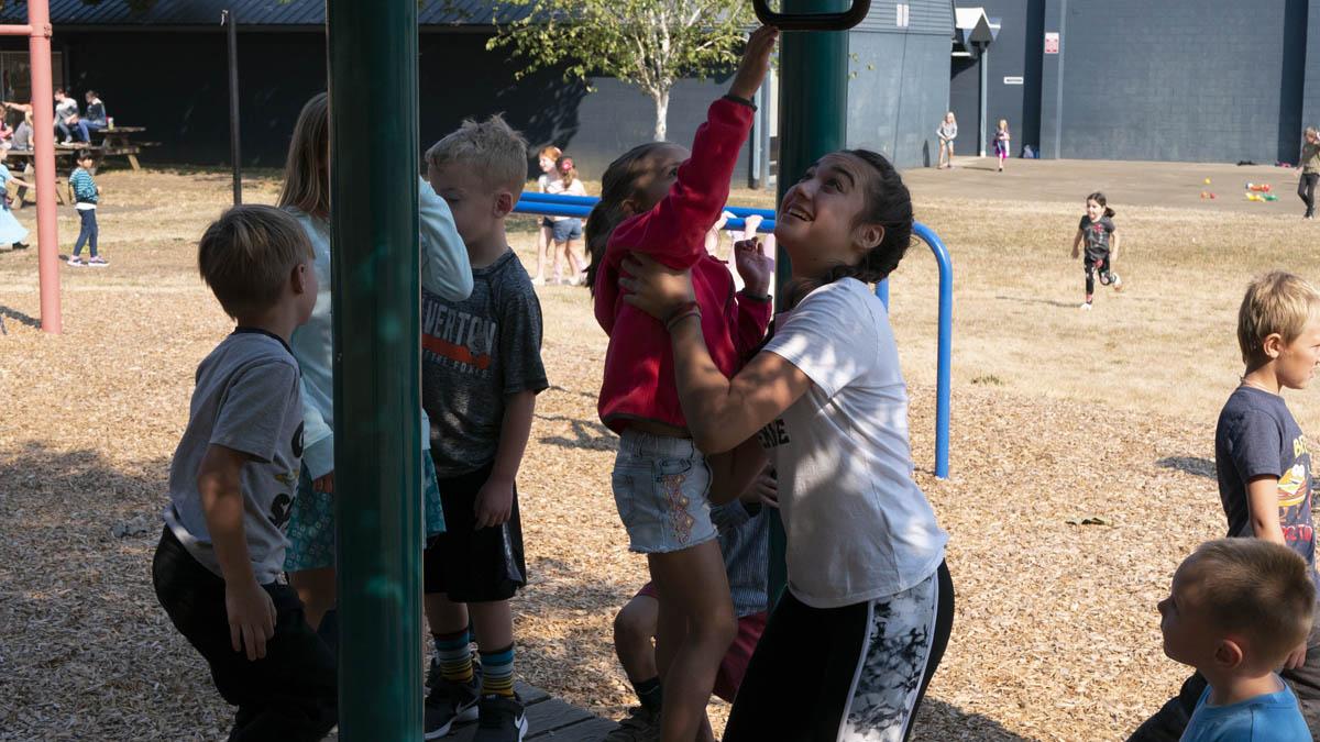 Lily Hayashida Helps a Kindergartener at Recess