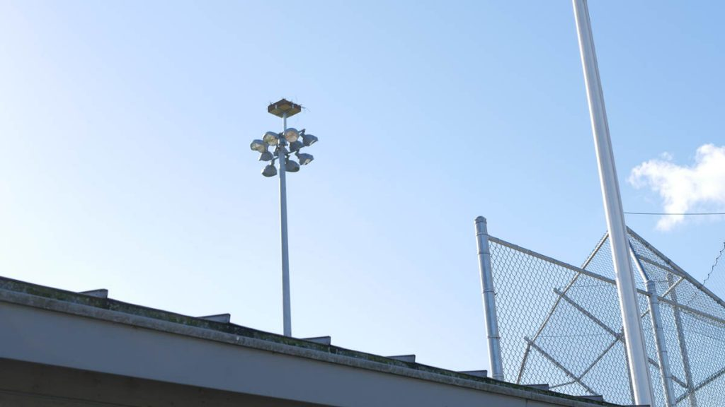 The Osprey nest now resides safely several feet above the top of the lights.