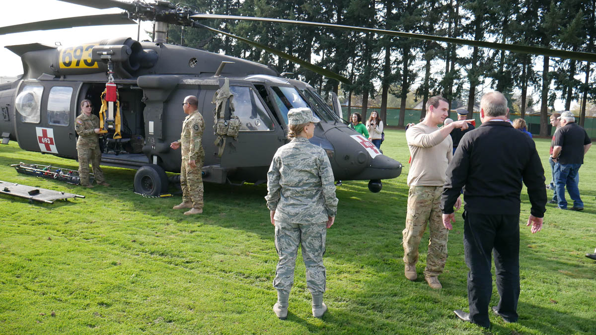 A Blackhawk helicopter sits in the field just north of Silverton Middle School as part of the Veteran's Day celebration